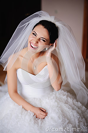 Portrait of a Gorgeous bride bursts of laughing