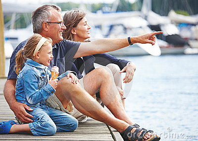 Portrait of grandparents with granddaughter