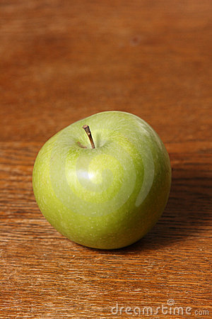 Free Portrait Green Apple On Timber Stock Photo - 6507160