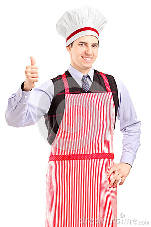 A portrait of a guy wearing apron and giving thumb up