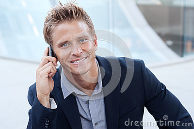 Portrait of handsome business man using cell phone