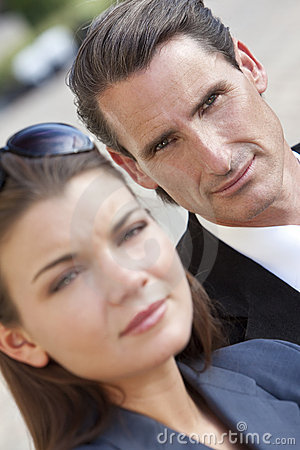 Portrait of Handsome Businessman & Woman Couple
