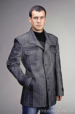 Portrait of handsome man in coat