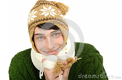 Portrait of a handsome man dressed for a cold winter smiling.  Man in sweater with hat and scarf.