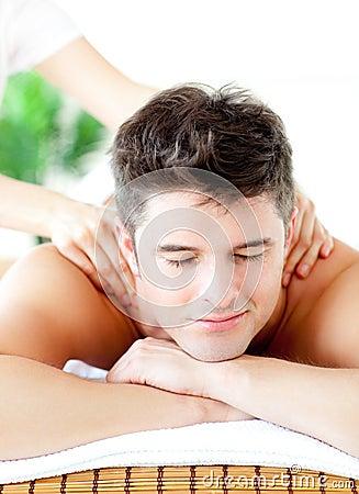 Portrait of a handsome man having a back massage