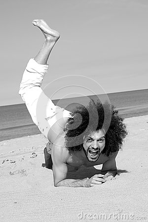 Portrait of handsome man having fun on the beach