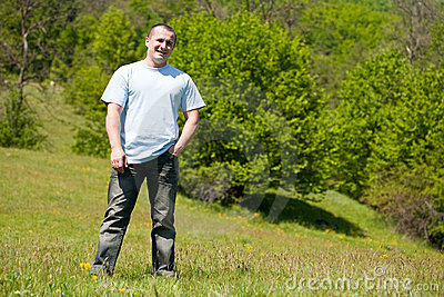 Portrait of a handsome man outdoor in a field