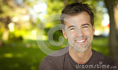 Portrait Of A Handsome Man Smiling At The Camera Stock Photo