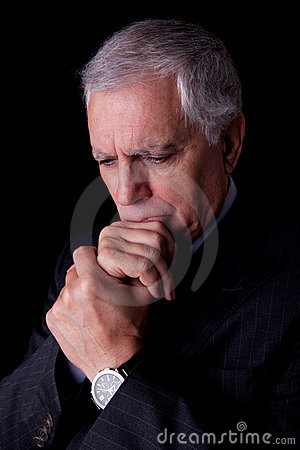Portrait of a handsome mature businessman thinking