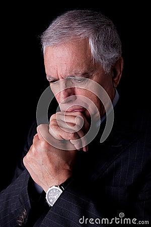 Portrait of a handsome mature businessman thinking