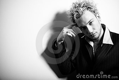 Portrait of handsome stylish blond man in suit