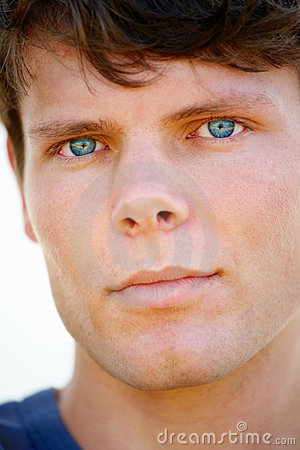 Portrait of a handsome young guy with blue eyes