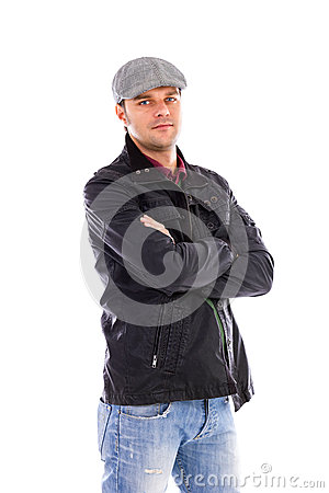 Portrait of a  handsome young man with arms folded