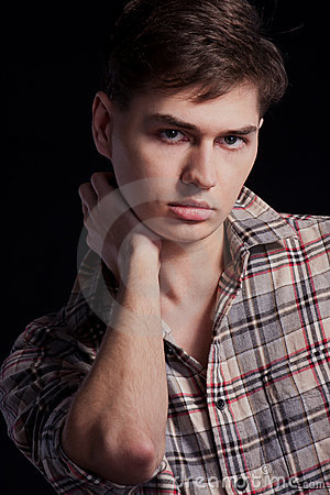 Portrait of a handsome young man in a plaid shirt