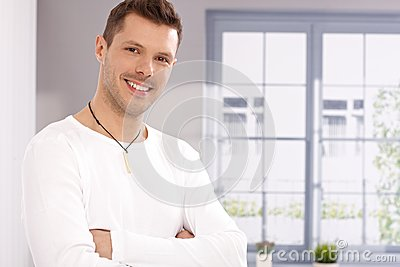Portrait of handsome young man by window