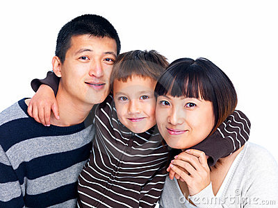 Portrait of a happy Asian family on white