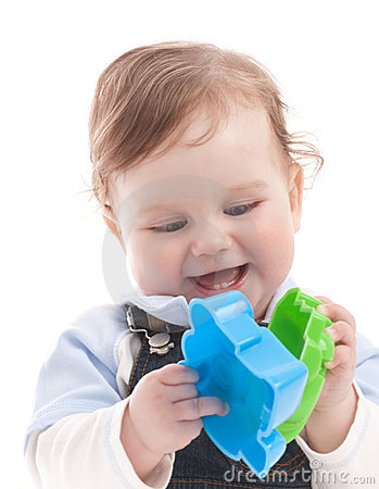 Portrait of happy baby boy playing with toys