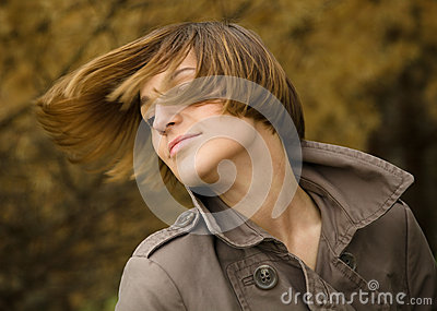 Portrait of a happy beautiful woman in autumn park