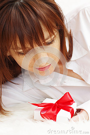 Portrait of happy beautiful woman with gift box