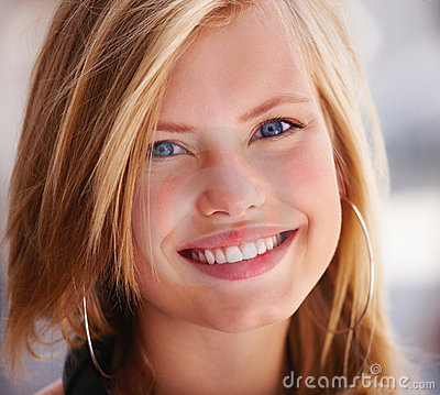 Portrait of a happy beautiful young girl