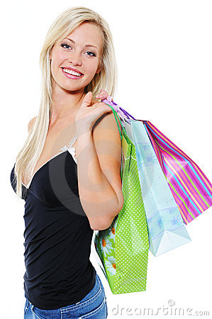 Portrait of happy  blonde woman with  purchases