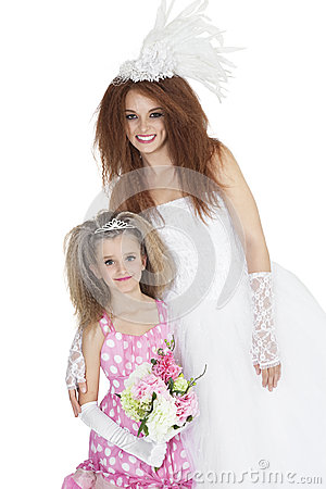 Portrait of happy bride with bridesmaid holding bouquet over white background