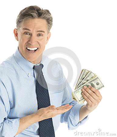 Portrait Of Happy Businessman Gesturing At Dollar Bills