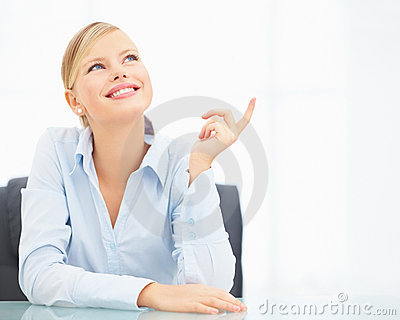 Portrait of happy businesswoman pointing