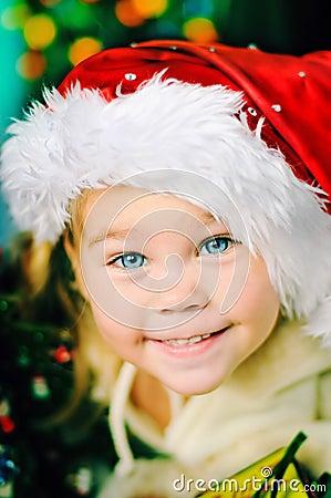 Portrait of happy Christmas girl in Santa s hat