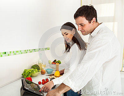 Portrait of a happy couple preparing food