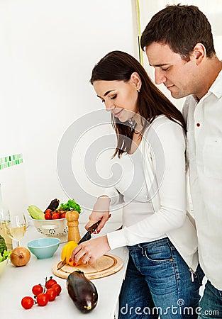 Portrait of a happy couple preparing food