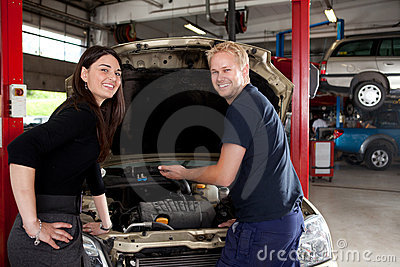 Portrait of Happy Customer and Mechanic