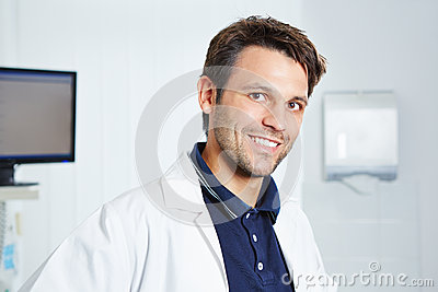 Portrait of happy dentist in lab coat