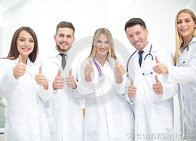 Portrait of happy doctors team showing thumbs up Stock Photo