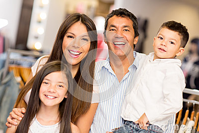 Happy family in a clothing store