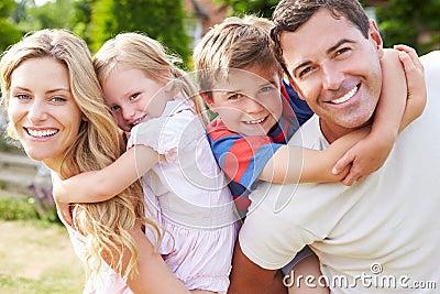 Portrait Of Happy Family In Garden