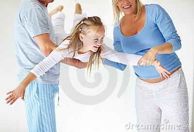 Portrait of happy family in a playful mood