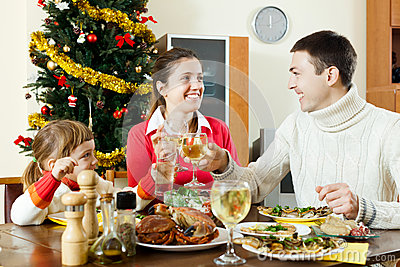 Portrait of Happy family of three celebrating Christmas