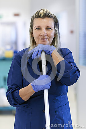 Portrait of happy female cleaner smiling