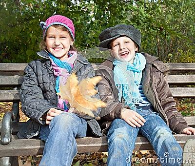 Portrait of happy girl and boy  enjoying in fall