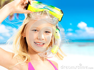 Portrait of the happy girl enjoying at beach