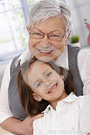 Portrait of happy granny and granddaughter