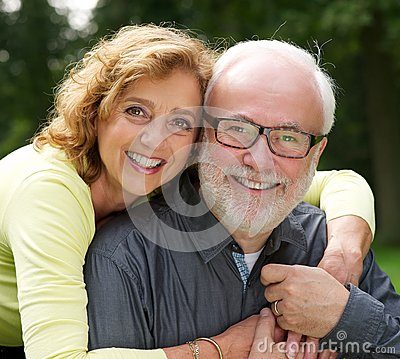 Portrait of a happy husband and wife smiling outdoors