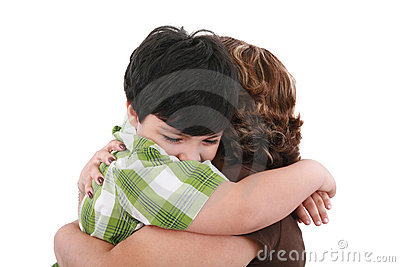 Portrait of happy kid embracing his mother