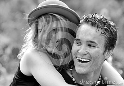 Portrait happy laughing young first love couple