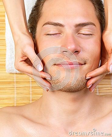 Portrait of happy man, hands giving face massag