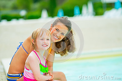 Portrait Of Happy Mother And Baby Girl Near Pool Stock Photo Image 44277229