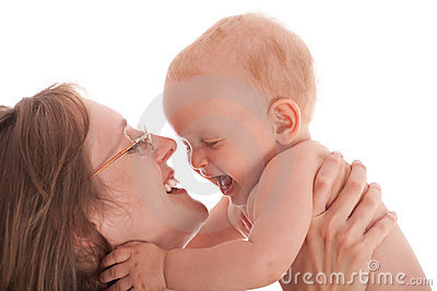 Portrait of happy mother with joyful baby