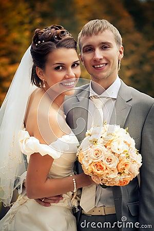 Portrait of happy newlyweds