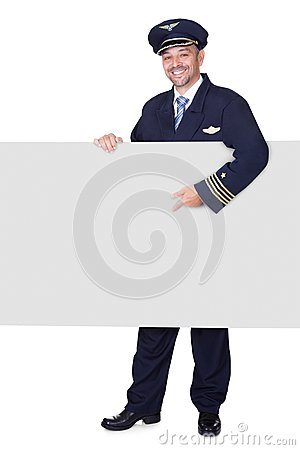 Portrait Of Happy Pilot Holding Blank Placard
